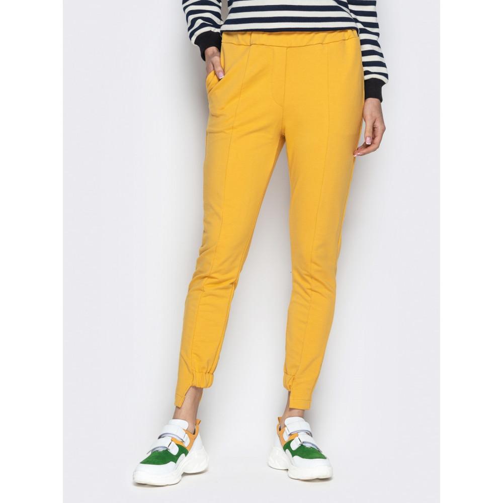 Зауженные брюки горчичного цвета на резинке фото 1