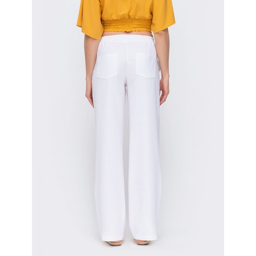 Белые льняные брюки-клёш с карманами фото 2