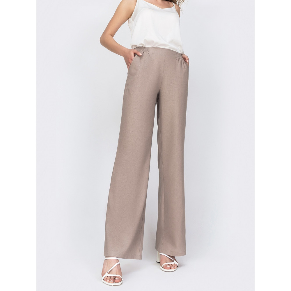 Льняные брюки-клёш с удобными карманами фото 1