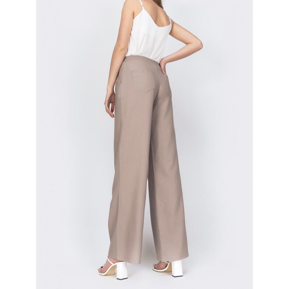 Льняные брюки-клёш с удобными карманами фото 2