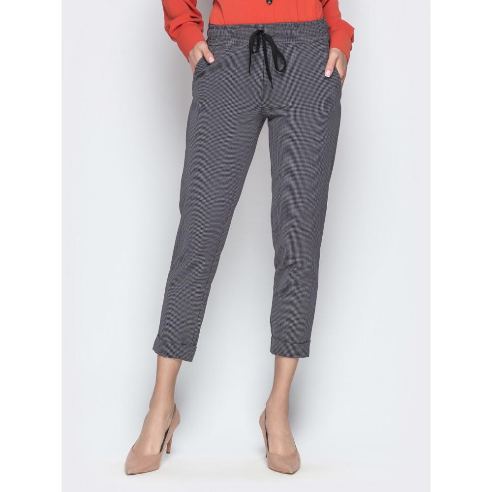 Зауженные брюки с подворотами фото 1