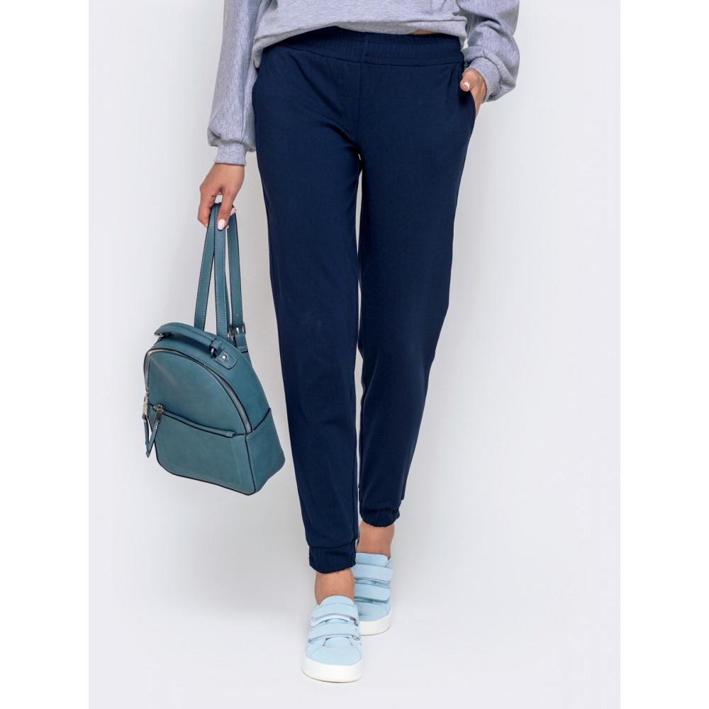 Базовые темно-синие брюки средней посадки фото 1