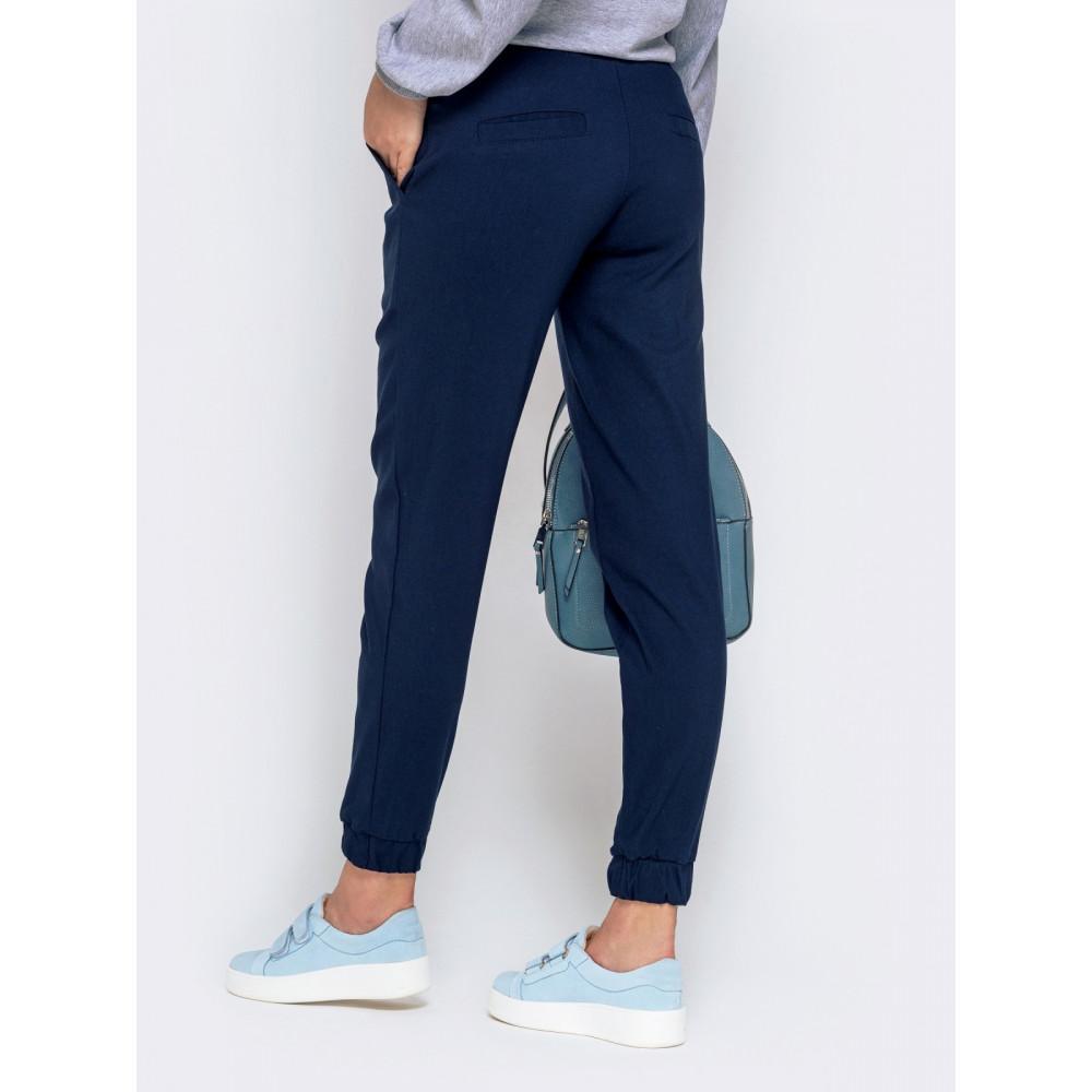 Базовые темно-синие брюки средней посадки фото 3