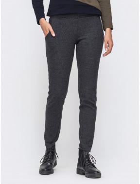 Зеленые брюки в геометричный принт