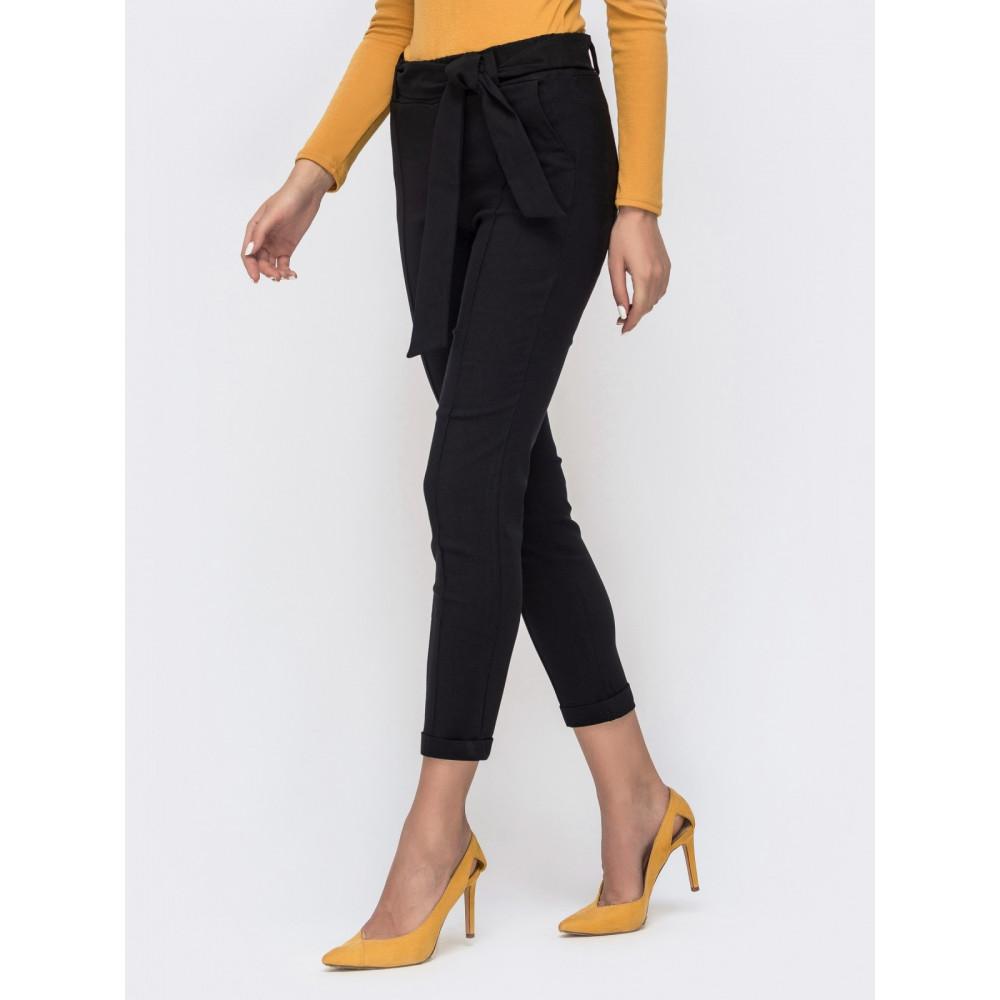 Красивые брюки-дудочки черного цвета фото 2